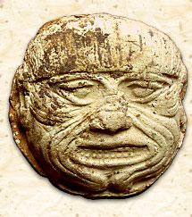Оскалившаяся голова Кумбабы. Глиняный барельеф