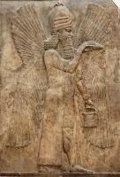 Древнеассирийский каменный рельеф, изображащий Джинна